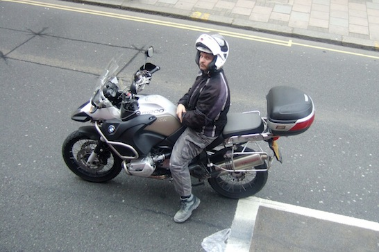 A motorcyclist returns my scrutiny