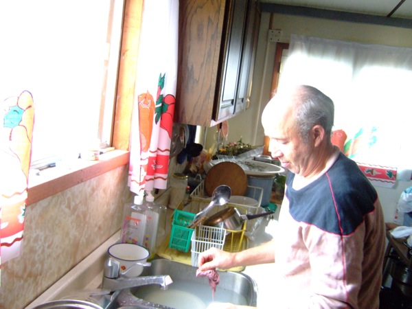 Dad washing the dishes